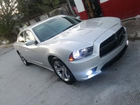 Dodge Charger  2012 6 cil trans. Se regulariza